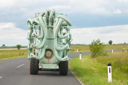 suction vehicle on the road Archivio Fotografico