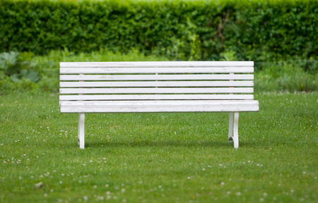 timber bench seat: white painted bench in a park