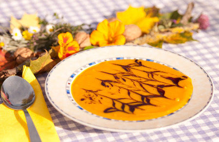 harvests: creamy hokkaido pumpkin soap on a decorated table Stock Photo