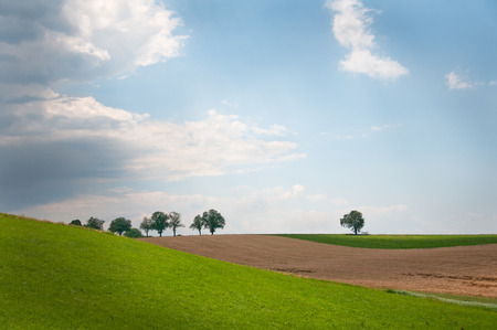 reclusion: rural hill land on a gloomy day in Austria Stock Photo