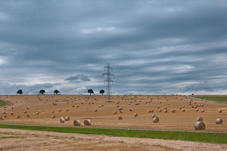 electrical tower between hay bales