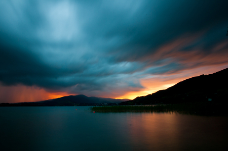 reclusion: sunset over the mountain lake Stock Photo
