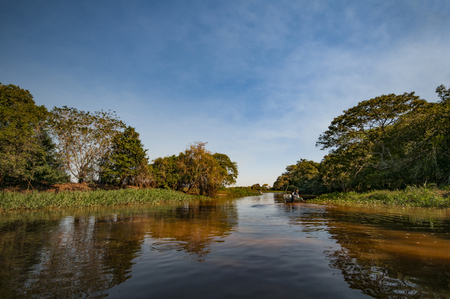 boat drivers on the Rio Negro in the Pantanal in Brazil Banco de Imagens