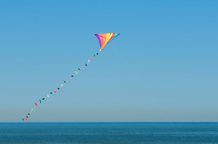 colorful kite flying in the sky - North Sea in Texel - Holland Netherlands Stock Photo