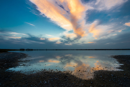 sunset on the Warmsee in the national park Neusiedleree Seewinkel - Darscho Apetlon Burgenland Austria - wide angle shot