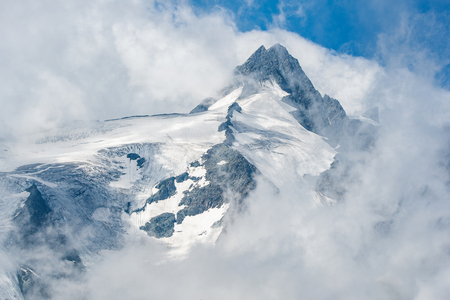 Großglockner mountain top in the fog - Austria Stock Photo