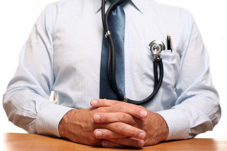Doctor Hands on Table in Conference Room. Stock Photo - 10031792