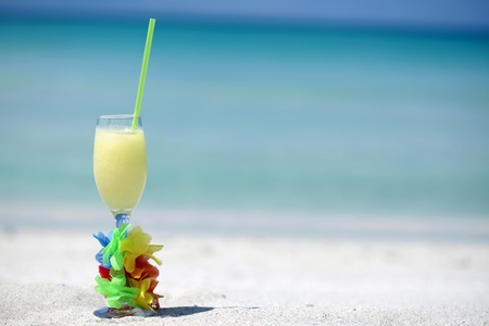 Pina Colada cocktail on Caribbean beach with copy space photo