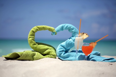 Towels and cocktails on beach photo