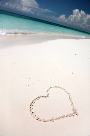 Heartshape in sand on tropical beach photo