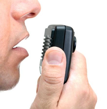 cb: CB radio microphone near the man mouth