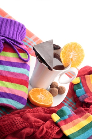 Warming hot water bottle and chocolate