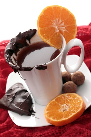 Cup of warming chocolate and orange Stock Photo