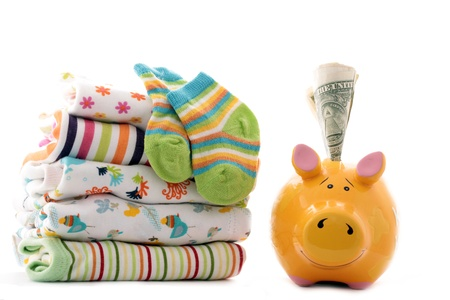 Clothing for babies and piggy bank Stock Photo