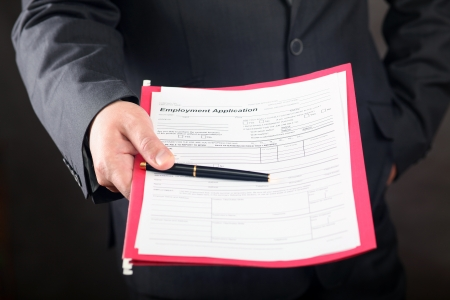 Employment Application Form in Businessman hand