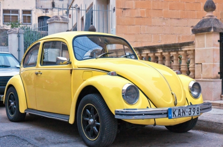 This is a yellow Volkswagen Cox in Valletta