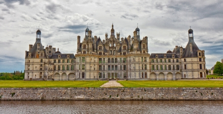 Chambord Castle rear view with a cloudy sky