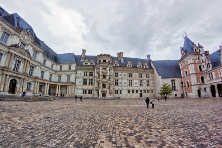 Castle of Blois courtyard, France, by a cloudy day Editorial