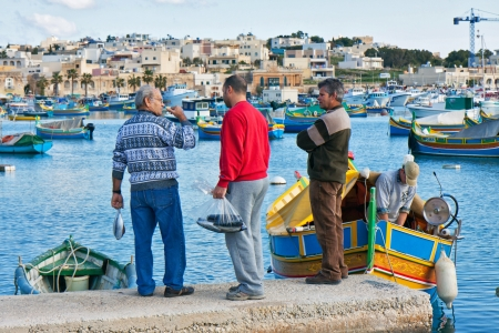 Fishermen on the port of Marsaxlockk in Malta