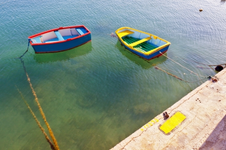 rowboats: two small coloured boats waiting for who knows what Stock Photo