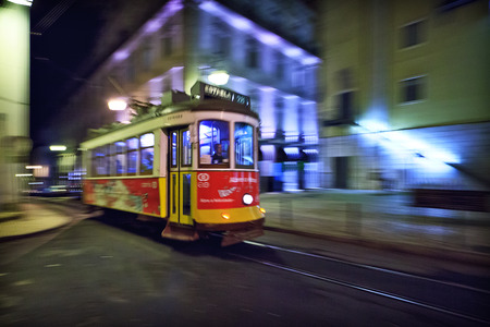 Lisbon tram 28View of the traditional yellow Tram 28 passing through the streets of Lisbon, Portugal providing innercity public transport