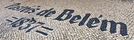 nata: Pasteis de Belem sign inlaid in mosaics in the floor - the Pasties de Belem is a famous historical bakery cafe started in 1837 in Lisbon known for its paleis de nata pastries