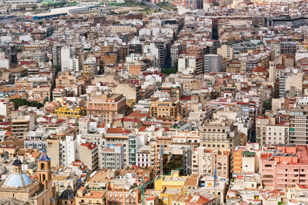 Rooftop view of the architecture and densely packed buildings in Alicante, Spain, a coastal port popular with tourists photo