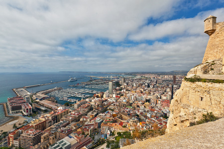 tourist destination: Alicante harbour and the Medtiterranean coastline viewed from Santa Barbara castle in Spain, a popular tourist destination