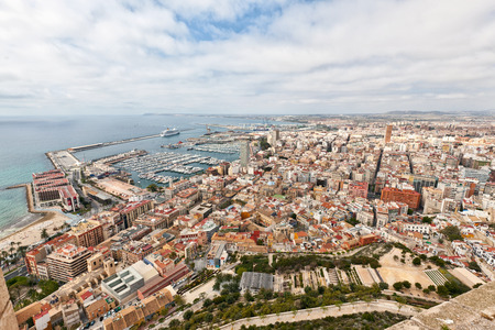 tourist destination: Aerial view of the Medterranean port and marina in Alicante, Spain looking over the rooftops of this popular tourist destination