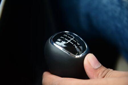 A five speed manual shift car gear lever
