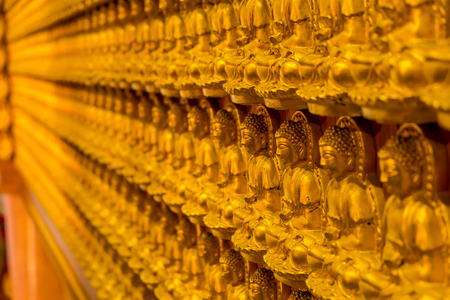 veneration: Pattern of golden wood carving buddha sculpture on chinese temple wall