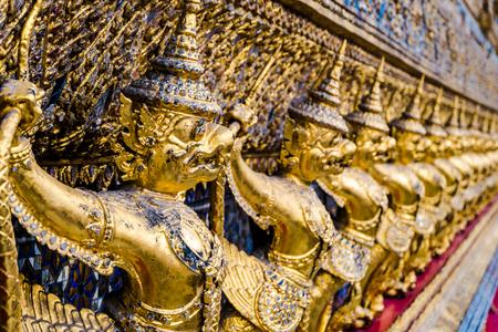 garuda: Golden garuda pattern standing at wat pha kaew
