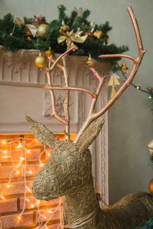 full size: Hand made Cristmas deer near fireplace, FULL SIZE Stock Photo