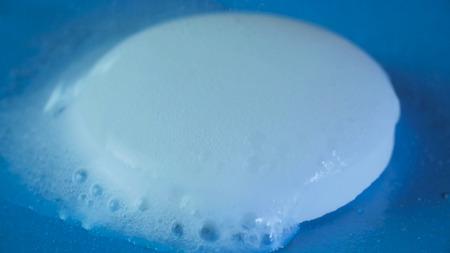 Effervescent pills dissolving in water, aspirin. Medicine concept. Macro Shot Stock Photo