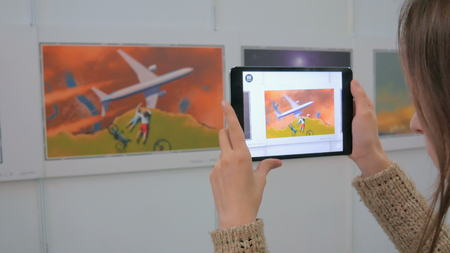 ar: NIZHNIY NOVGOROD, RUSSIA - JANUARY 28, 2017: Exhibition of modern technologies. Tablet augmented reality app. Future and technology concept