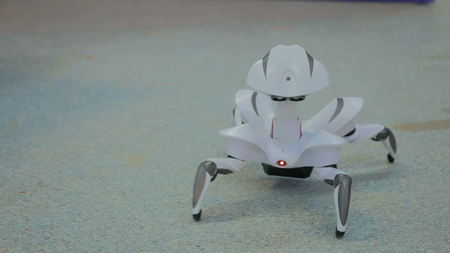 Futuristic robot spider dancing. Exhibition of modern technologies. Future and technology concept