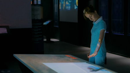 Woman using interactive display with no touch control technology. Education and modern concept