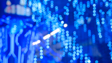 Abstract defocused blue lighting bokeh at futuristic modern technology exhibition