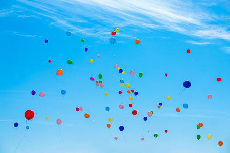 Many colorful balloons flying in the sky. Birthday, celebration, festival, wedding, childhood, hope and anniversary concept