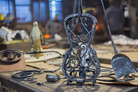 Blacksmith decorative elements at forge, workshop. Handmade, craftsmanship and blacksmithing concept
