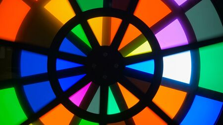 Spinning circles with multicolors glasses - sectors change colors - overlay effect. Science, physics and optical concept