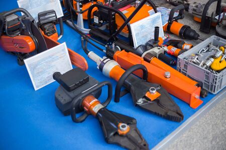 Special equipment of rescue worker - metal cutters, chainsaw at emergency services show