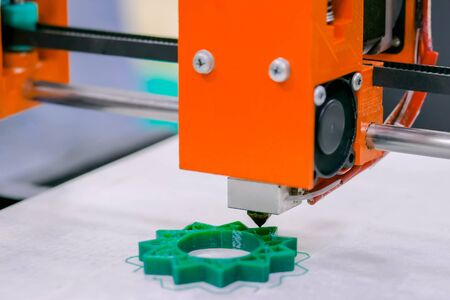 Three dimensional printer during work at 3d science technology exhibition. 3D printing, additive technologies, engineering and prototyping industry concept