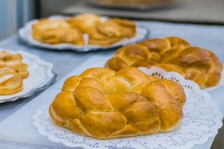 Freshly baked breads on plate at cuisine of cafe, restaurant or bakery. Pastry, catering, culinary, gastronomy and food concept