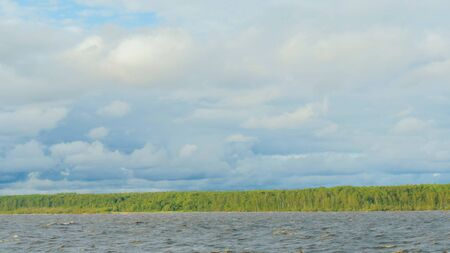View on riverside of Volga River with trees from moving cruise ship. Overcast, cloudy. 版權商用圖片