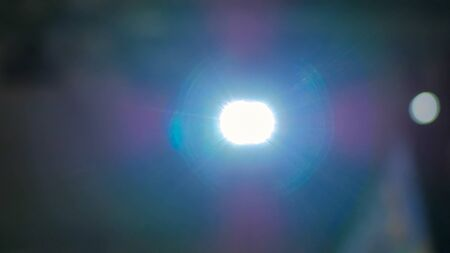 Abstract background - Front view of digital film projector, lens flares