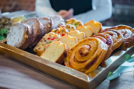 Assortment of delicious freshly baked sweet and puff pastry for sale on counter of shop, grocery, market, cafe or bakery. Dessert, food and traditional french cuisine concept Фото со стока