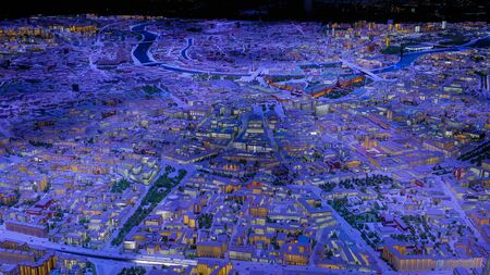Interactive 3D architectural model of Moscow with colorful blue and yellow dynamic illumination. Technology, architecture and urbanization concept