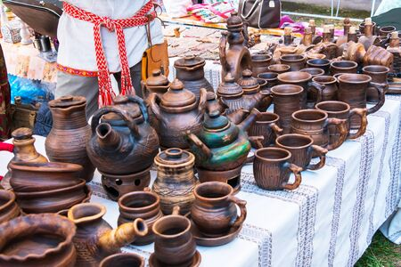 Traditional ceramic products, souvenirs at outdoor market. Handmade, art and handicraft concept