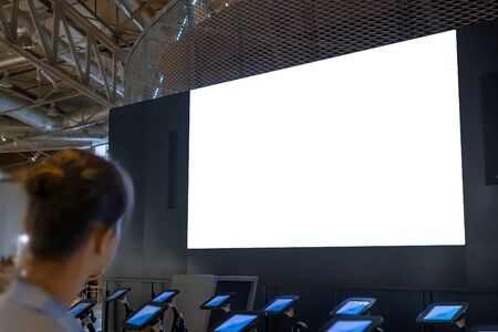 White screen, technology, isolated, futuristic, template, mock up, education concept. Woman looking at large blank interactive white display wall at science exhibition, museum or cinema Banque d'images